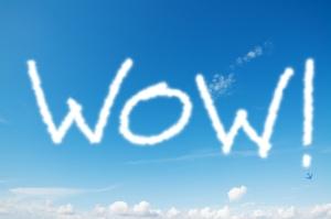wow written in the blue sky
